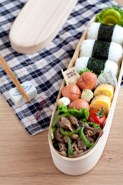 I like the structure of the meats and the onigiri, but I think this bento's a little lacking in veggies. Probably add more beef, and swap the sausages for a salad.