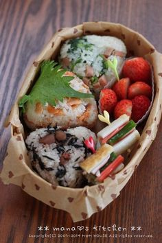 One chicken and seaweed, one pickled plumb, and one salmon onigiri with pickled vegetables and strawberries