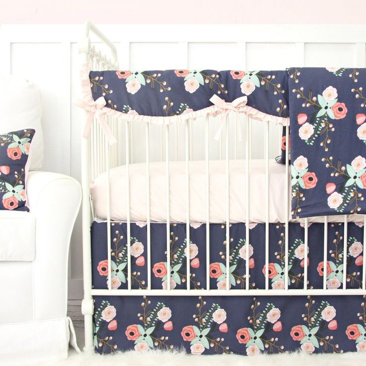 This dark floral blush pink and navy crib bedding set is adorable for any baby girl's nursery!