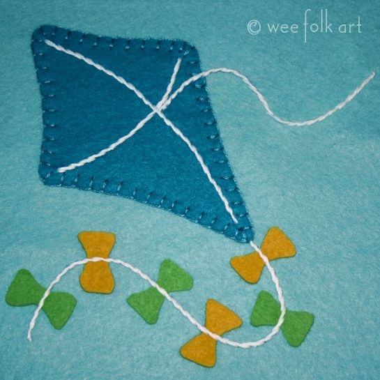 Kite appliqué. Would be cute to do for an embroidery hoop wall hanging or front of onesie.