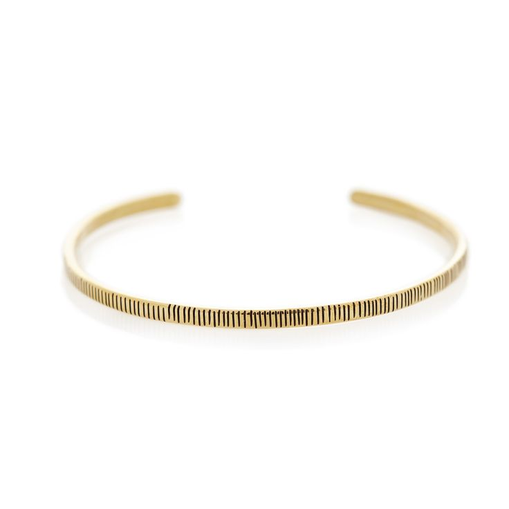 A thin, flat, cuff bangle with striped edge patterns.