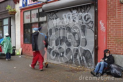 Graffiti and homelessness seen in Vancouver's DTES along Hastings Street. Picture taken Nov 2015
