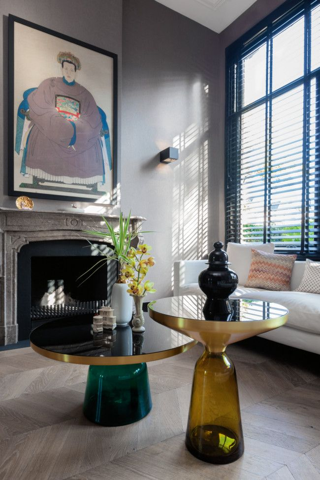 In the front sitting area, a Chinese ancestor portrait hangs above the fireplace and Sebastian Herkner's hand-blown glass and metal 'Bell' ...