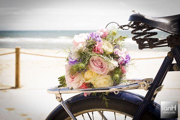 Beautiful bridal bouquet on the beach Copyright: ianH photography www.ianH.co.uk #beachwedding #bridalbouquet #arcadeflowers