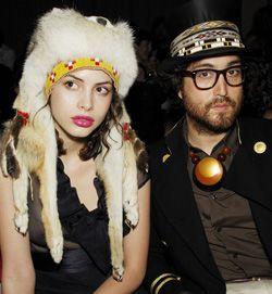 .woman in native-american chic headdress.sean lennon beside her.VsV.