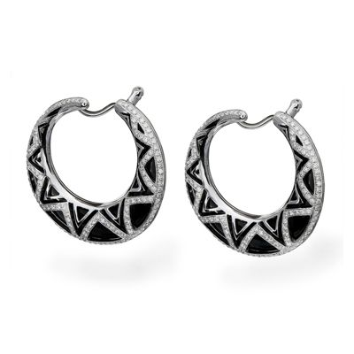 These striking 18K white and onyx earrings are comprised of .98ctw round white D...