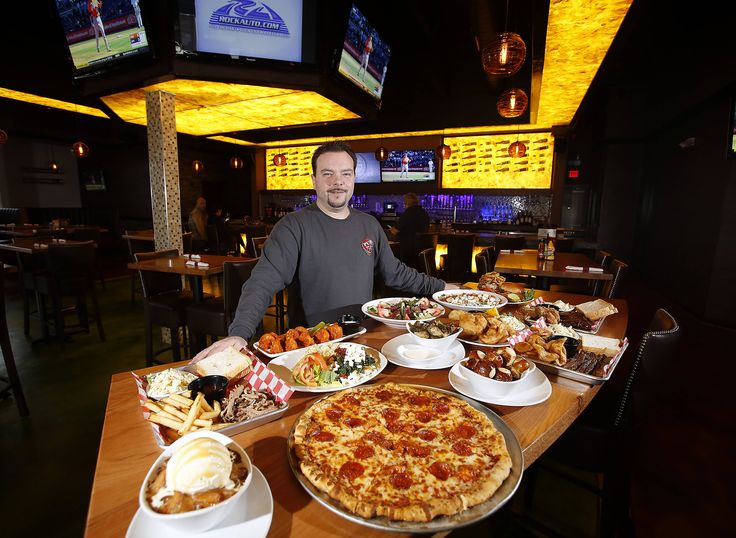 Manager Matt Osborne shows but a small sample of fare the kitchen plates at Pub 56 in Aurora.