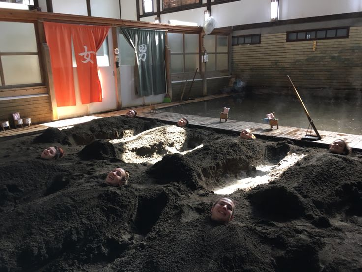This is how they relax in Japan  ! Sand bath in Beppu,Japan ! Love it !!!