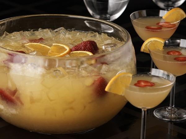 Mimosa Punch -     2 quarts of fresh orange juice      1 2-liter bottle of ginger ale      1/2 cup orange liqueur (Grand Marnier)      Orange slices      Fresh strawberries, sliced or halved depending on size      1 (750 ml) bottle chilled dry Champagne or sparkling wine      ice cubes