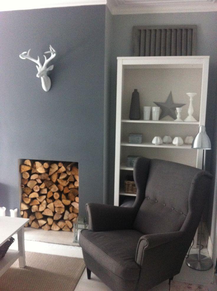 Calm grey living room minus the fake deer head.