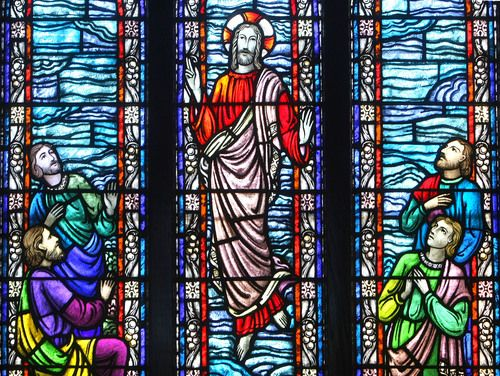 A stained-glass window in St. Peter's Catholic Church depicts Christ's ascension to heaven