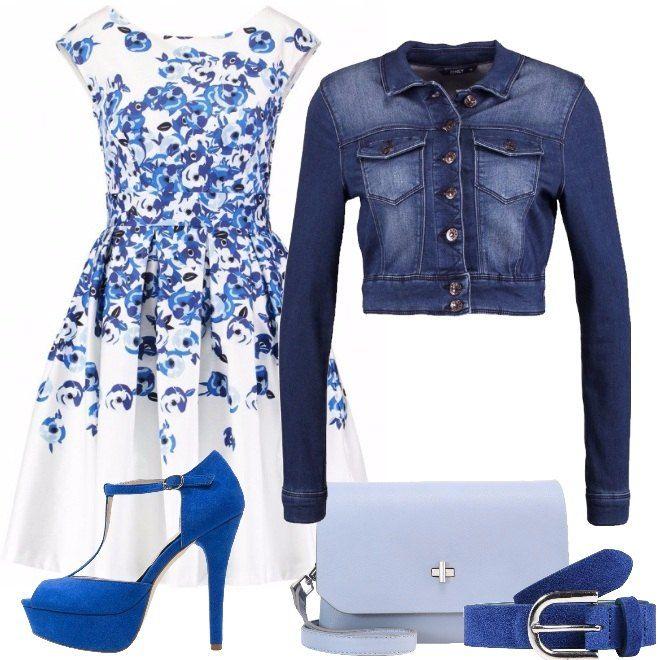 La linea del bellissimo vestito, con fantasia floreale sui toni dell'azzurro è del blu è perfetto per le donne a triangolo, ma si adatta anche alle donne rettangolo e triangolo invertito. La giacca di jeans corta è deliziosa e rende il look più casual. La cintura sottolinea il girovita, che è il punto di forza della silhouette a triangolo. Completano il look la borsa a tracolla color azzurro polvere ed i sandali con tacco alto e plateau, che riprendono le tonalità del look.