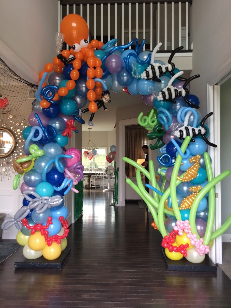 Birthday for toddler. Under the sea, shark party theme, balloon arch and decor/ decorations! Best balloon arch ever designed by Beth's Home Deseyen, Inc. balloon artist- Anthony's Balloons in Chicago!