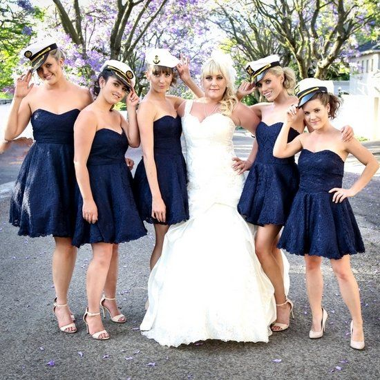 Nautical but very, very nice - this gorgeous wedding is full of sweet navy and white details. (Pics: Lauren Kim)