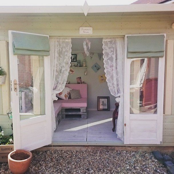 Pin for Later: He Shed, She Shed — All the Things You Can Do With Backyard Sheds  Lace curtains lend this she shed a decidedly feminine vibe.