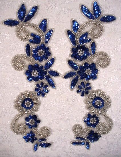 Blue & Silver Mirror Pair Sequin Beaded Appliques 0183  Measures: 10 x 3.5 each  You are buying a pair.   This applique pair is great for costumes such as belly dance, ice skating and evening gowns.  Use for any of your craft projects.  Simply sew or glue on and add a little sparkle to anything!  Glorys House is the place for rhinestone and sequin appliques and trims. We keep over  4000 items in stock.  We will be listing more of our beautiful items in the near future. Please email  us if...
