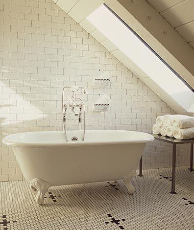 our attic bath!  Clawfoot tub + floor to ceiling subway tiles + a skylight design Eric Martin via farmhouseurban.com