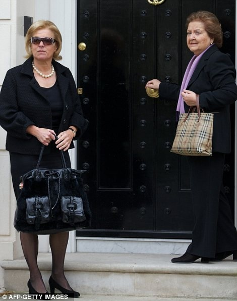 Grieving: Carol Thatcher with Cynthia Crawford, her mothers long-serving personal assistant, outside the house today
