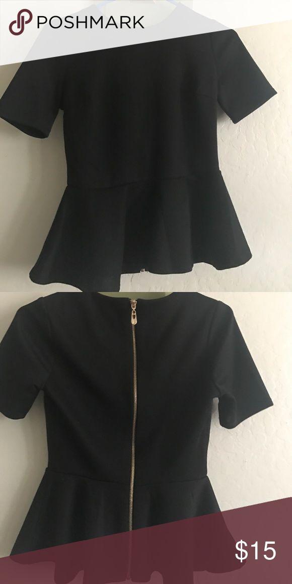 NWOT black peplum top Black peplum top cute with a skirt! Tops Blouses