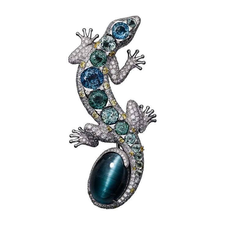 High Jewellery Cartier Royal brooch, 18K white gold, one cat's eye tourmaline (13.71 carats), coloured sapphires, yellow diamond eyes, yellow and white brilliant-cut diamonds.