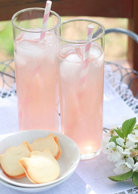 Rose scented lemonade 1 cup sugar 1 cup water 2 strawberries 2 tablespoons rose water 1 cup freshly squeezed lemon juice cold water and ice