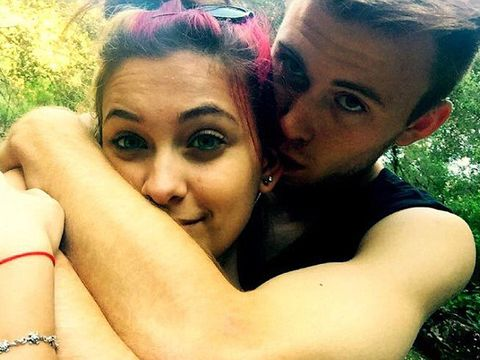 Paris Jackson's boyfriend Chester Castellaw posted a cute pic on Instagram of the couple rockin' matching black tanks and wild 'dos.