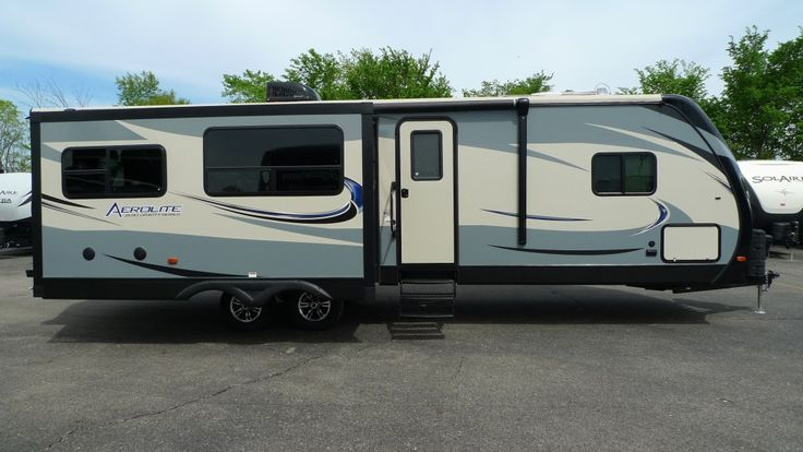 FEEL RIGHT AT HOME WHEREVER YOU GO!!!  2016 Dutchmen Aerolite Luxury Class 302RESL A convenient remote control lets you operate your slide outs, stabilizer jacks, electric awning, and patio lights right from the palm of your hand so you can forget about any extensive campsite setup! Just pull this 34' long, 7003 lb. RV into your site, press a button, and get straight to the fun!  Give our Aerolite Luxury Class expert Norman Wells a call 231-730-3481 or send an email to norm@natlrv.com.