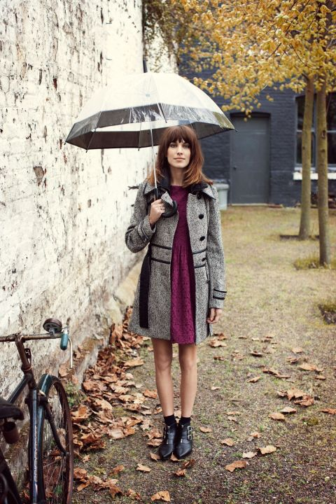 Grey and black tweed coat, burgundy purple dress, clear umbrella