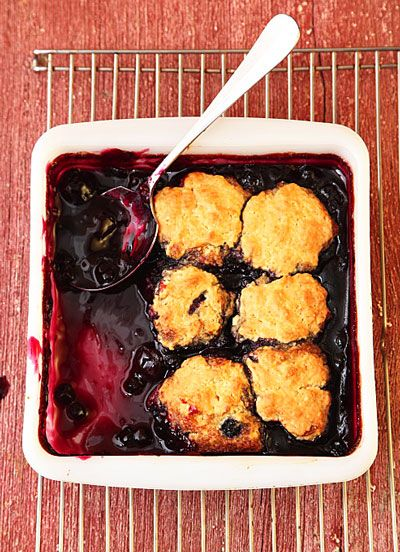 Blueberry-Cherry Cobbler-- Fluffy biscuits top warm, baked fruit in a quick cobbler flavored with cinnamon and almond extract.