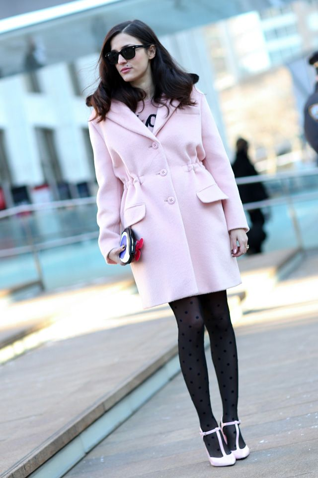 Eleanora Carisi in a baby pink coat and polka dot tights plus those white T-bars.#NYFW