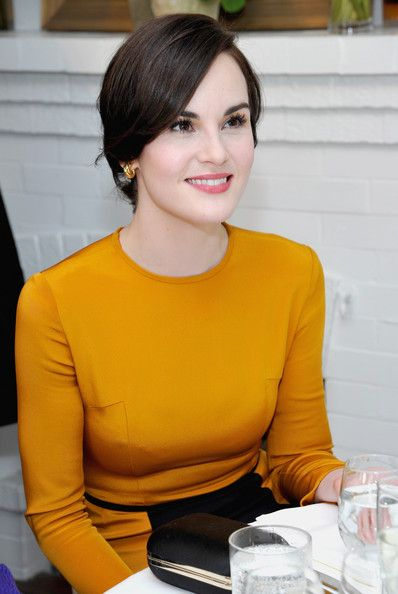 Michelle Dockery. Sleek, sculpted, controlled. This look might also suit a Dramatic Classic (which is what many devotees guessed for Ms. Dockery prior to Kibbe's correction), or possibly a Soft Classic, if paired with a sophisticated, tasteful pearl necklace.  But when paired with a head-to-toe Dramatic style, I believe this fits the bill for a Dramatic because it  does look oh-so-controlled and sleek.