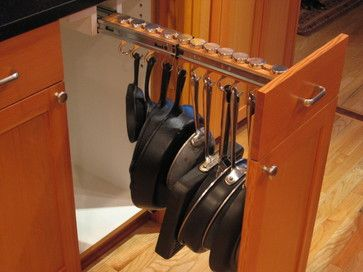 Pull out hanging drawer. Pots are accessible but can be tucked away by closing the drawer.