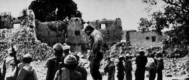 Afghan resistance fighters and the Hulk returning to a village destroyed by Soviet forces (1986)