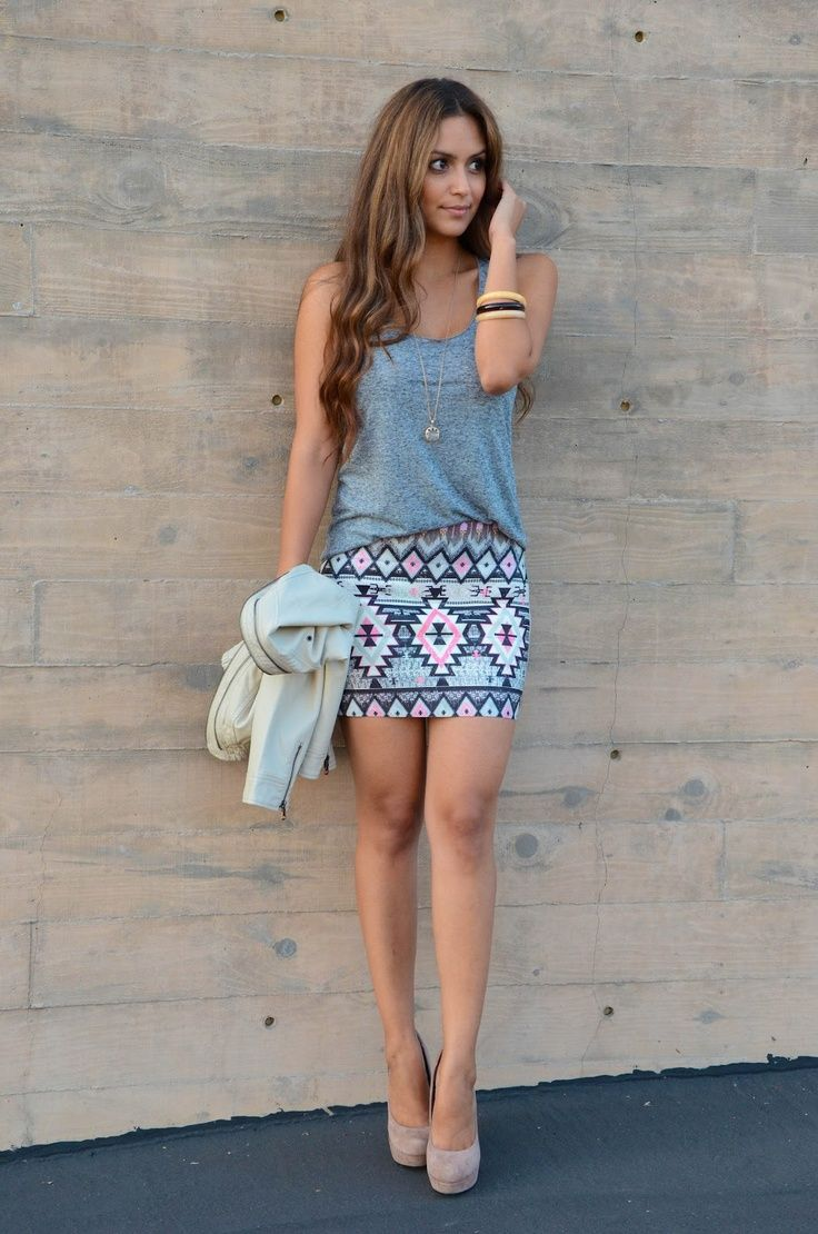 This loose fitting gray tank is a perfect match for this busy, patterned mini skirt with coordinating gray undertones