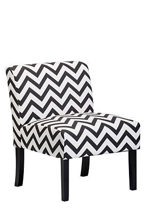 """The retro styling of this chair is perfect for an urban lounge setting. Upholstered in a tonal polyester, this chair is comfortable and practical.<div class=""""pdpDescContent""""><ul><li> Polyester</li><li> Pine and chip board</li><li> Birch wood legs</li><li> Assembly required</li></ul></div><div class=""""pdpDescContent""""><BR /><b class=""""pdpDesc"""">Dimensions:</b><BR />L64xW73xH81 cm<BR /><BR /><b class=""""pdpDesc"""">Fabric Content:</b><BR />70% Polyester 30% Linen<BR /><BR /><div><span…"""