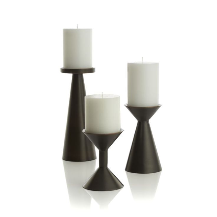 """Iconic meets conic in stylized spool-designed candleholders with a mid-century modern vibe.  Clean, contemporary pedestals of darkly lustrous iron are versatile decor accents on their own or grouped together. IronAccommodates up to 3""""-dia.  pillar candle, sold separatelyDust with soft dry clothMade in India."""