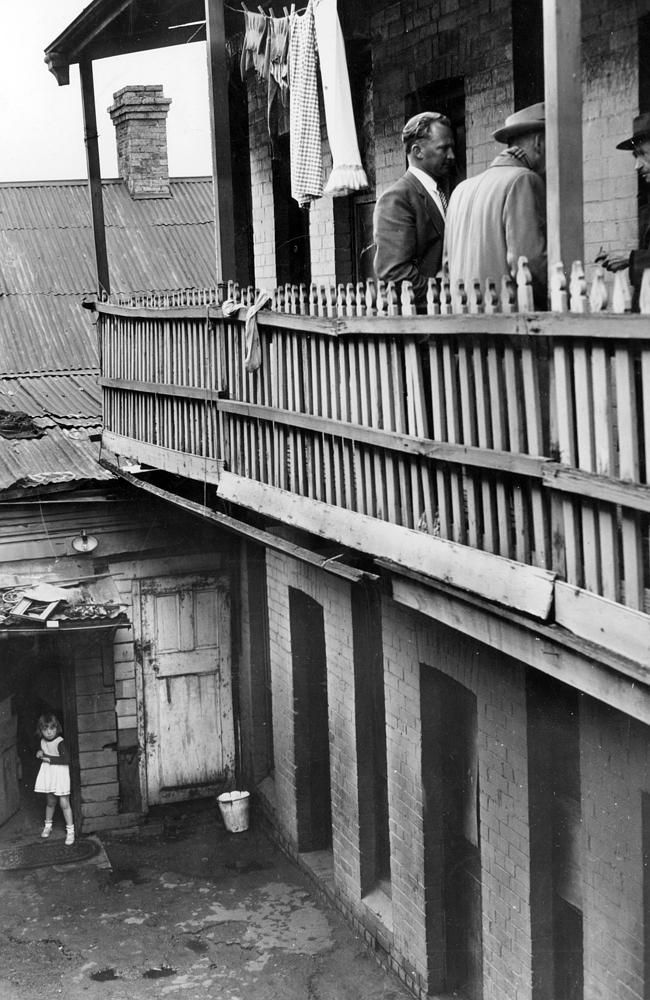 October 1955: Terrace of rooms behind a house at 50 Argyle St. Fitzroy. Tenants paid $1.76 for draughty single rooms.