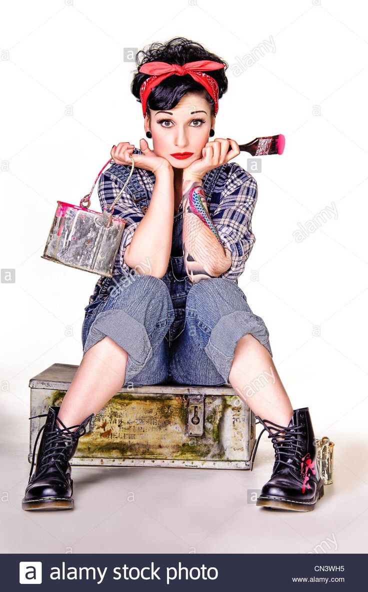Download this stock image: Young woman with paint pot and brush - CN3WH5 from Alamy's library of millions of high resolution stock photos, illustrations and vectors.