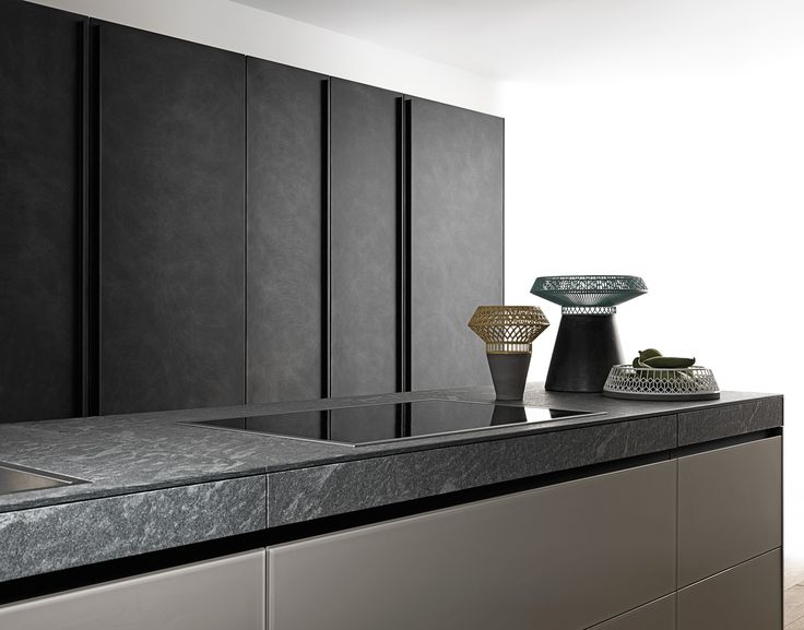 """'Genius Loci' (from Latin = """"spirit of place"""") is a wall or island kitchen inspired by the 'secretaire' or traditional writing desk that comes with secret drawers. Genius Loci a perfect balance between poetry and functionality."""
