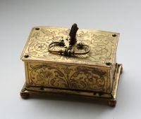Miniature casket, brass, pierced, engraved and gilded, the lock blued, made by the workshop of Michel Mann of Nuremberg (no maker`s mark), which was renowned for intricate lock mechanisms., South Germany, circa 1600.dimensions: 6.4 x 4.1 3.4 cm.
