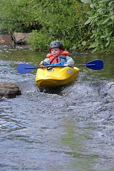 My baby nephew needs a Jackson Kayak Fun 1 (like this kid) so he can be my paddling buddy :)