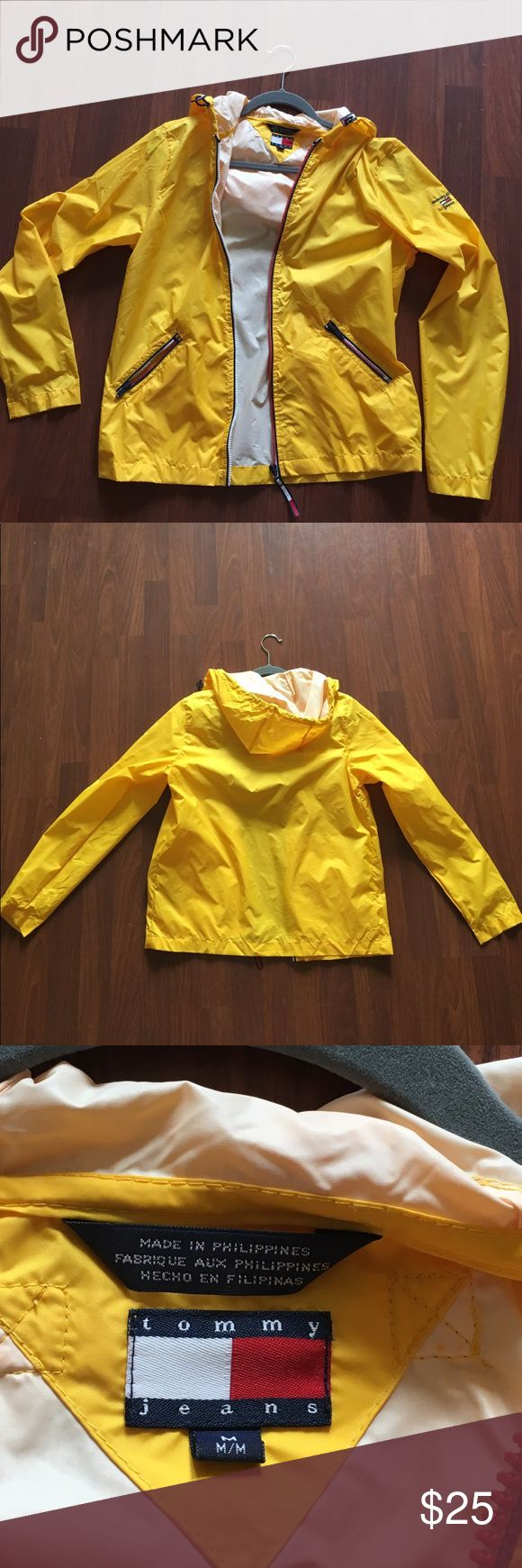 Tommy Hilfiger - Yellow Hooded Raincoat Tommy Girl yellow hooded raincoat. Zipper. Adjustable hood. Runs small. Tommy Hilfiger Jackets & Coats