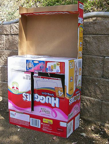 cardboard box kitchen from diaper boxes...which we sure do have a lot of.