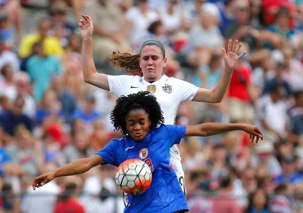 Heather O'Reilly and Kensia Destinvil of Haiti, Birmingham, Ala., Sept. 20, 2015. (Kevin C. Cox/Getty Images North America)