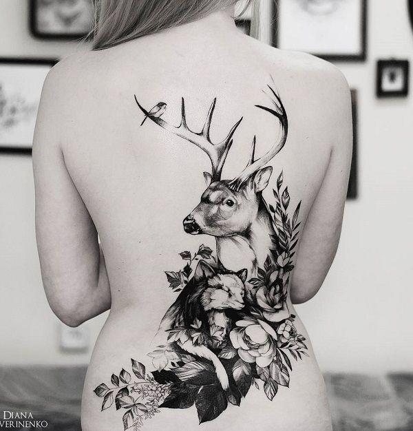 Deer with flower back tattoo - 45 Inspiring Deer Tattoo Designs