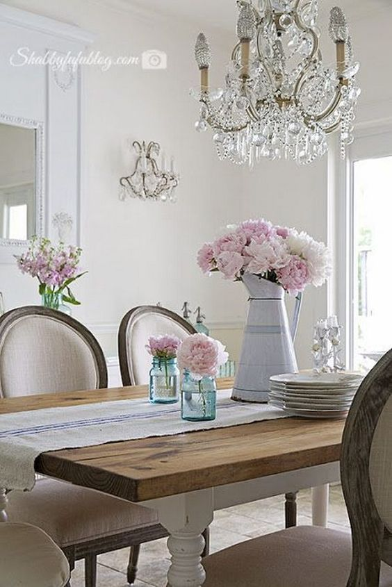 Shabby Chic Dining Room With Mason Jars, Pink Flowers and Gorgeous Chandelier.