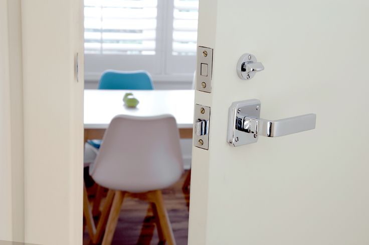 Tradco Hardware 'Rotterdam' lever in chrome on square back plate (0660). Shown with matching chrome privacy turn (1169). www.tradco.com.au www.tradco.co.nz  Architectural Hardware Door Furniture Door levers  Door Knobs