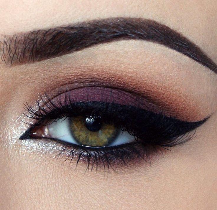 eye makeup, dark purple eye shadow, strong dark eyeliner and white shimmer in the inner eye corners