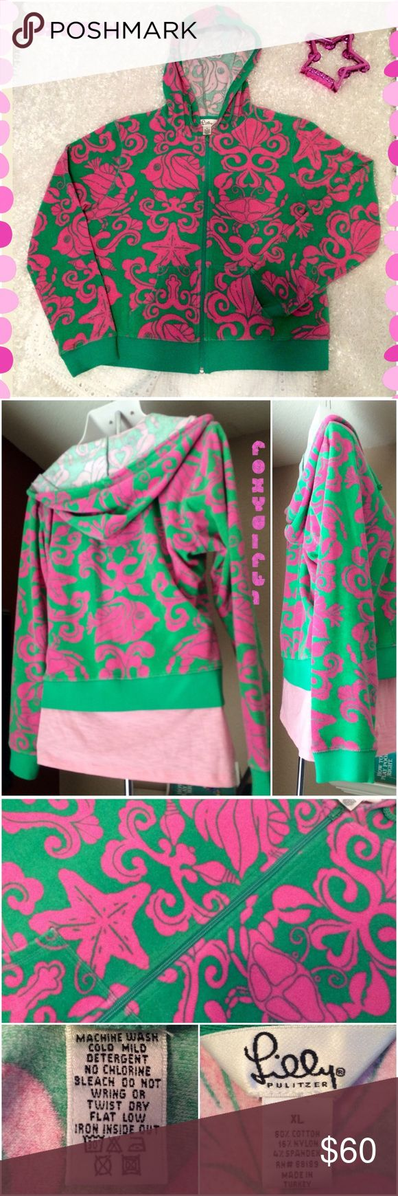 "Lilly Pulitzer Zip Up Hoodie ~ Adorable Lilly Pulitzer Zip Up Hoodie  Adorable Green with Pink Nautical Print   In Great Condition ~ No Marks, Fading or Stains! The Jacket zippers completely down the front, the Hood has a Draw String, & there are 2 front pockets. The Jacket is Light Weight & could also be used as a beach cover up. Measurements: Arm pit to Arm pit 22"" & Shoulder seam to hem 22"" ❌NO TRADE❌ Lilly Pulitzer Tops Sweatshirts & Hoodies"