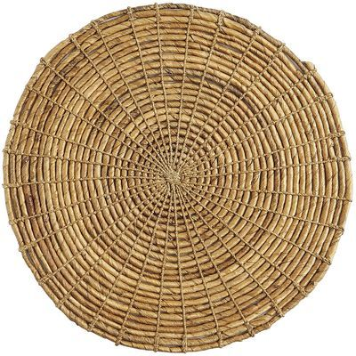 This round placemat is a natural choice for any occasion. Hand-woven of banana leaves by skilled artisans in Indonesia, each is unique and simply chic.